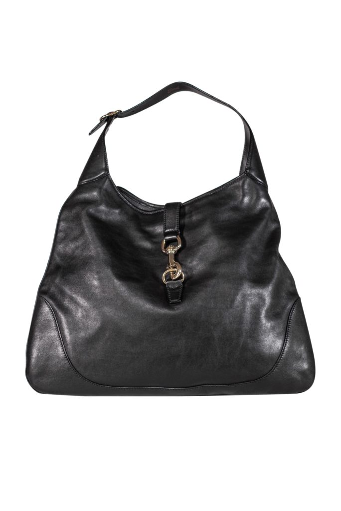 Gucci Black Leather Shoulder Bag | Spacious and stylish Gucci shoulder bag with a front lock closure. Made from leather and accented by gold toned hardware. Made in Italy.