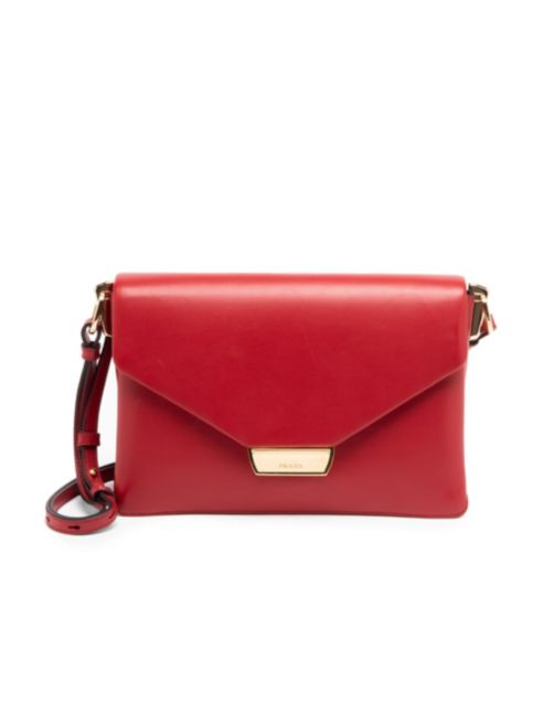 Prada Small Ingrid Leather Shoulder Bag    This red Prada leather shoulder bag has the Prada logo accent on the front and an adjustable crossbody strap, along with 2 interior compartments.