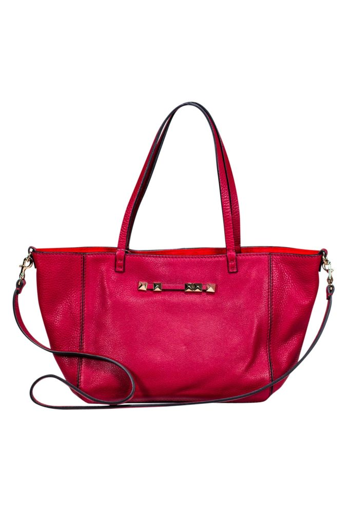Valentino - Red Leather Small Tote   This versatile leather tote is a must have! Whether you carry very little or your whole life in your bag, this Valentino piece can fit it all. Crafted with soft full-grain leather, this timeless tote can be your new favorite bag.