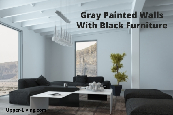Gray walls with black living room furniture.