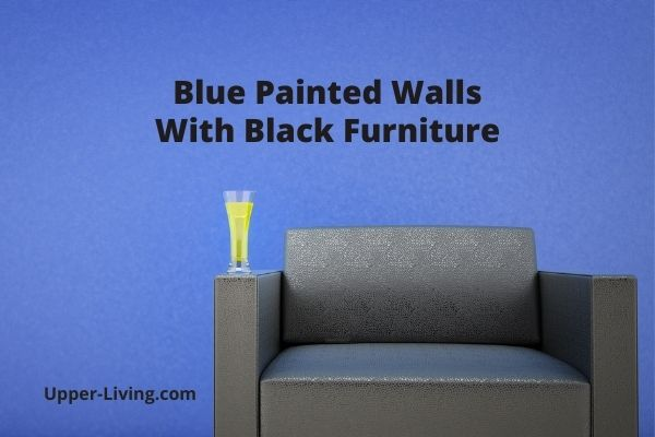 Royal Blue Wall with Black Living Room Furniture.